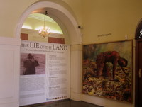Installation view of exhibition entrance, with Penny Siopis's 'Terra Incognita' (1991)