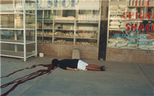 Nurse shot on her way to work by members of the AWB, who were randomly shooting at black people in Bophuthatswana, 1994