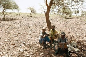 Three men rest at the side of the track between Bute Asbestos Mine and Heuningvlei in Northern Cape. 18 December 2002