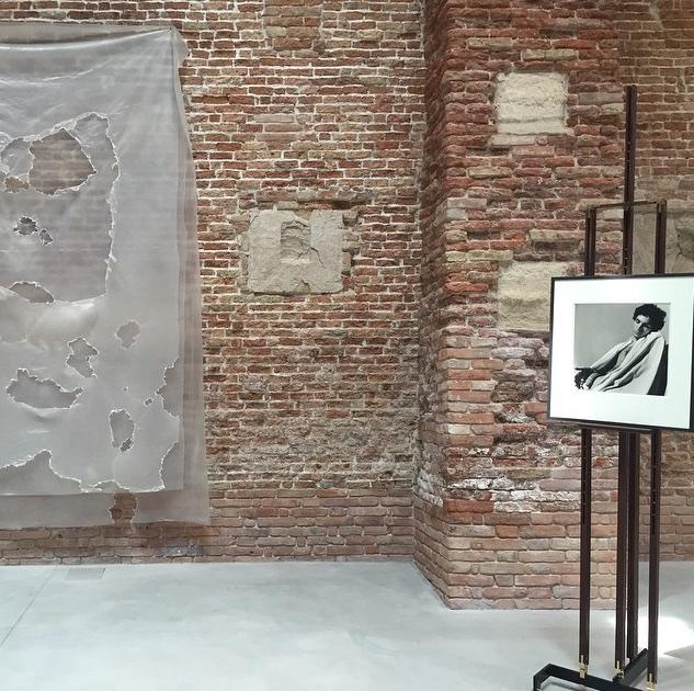 Installation view with David Hammons <i>Untitled</i>, 2007, Plastic, 325.1 × 226.1 cm and Peter Hujar, <i>Draped Male Nude (i)</i>, 1979, Gelatin silver print  50.8 × 40.6 cm