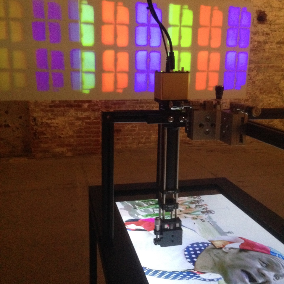 Mikhael Subotzky, <i> Pixel Interface<i> (2015) Three looped digital videos of varying length with sound, polycarbonate screen, three custom made steel tables, three custom made microscopes with objectives, three digital HD microscope cameras