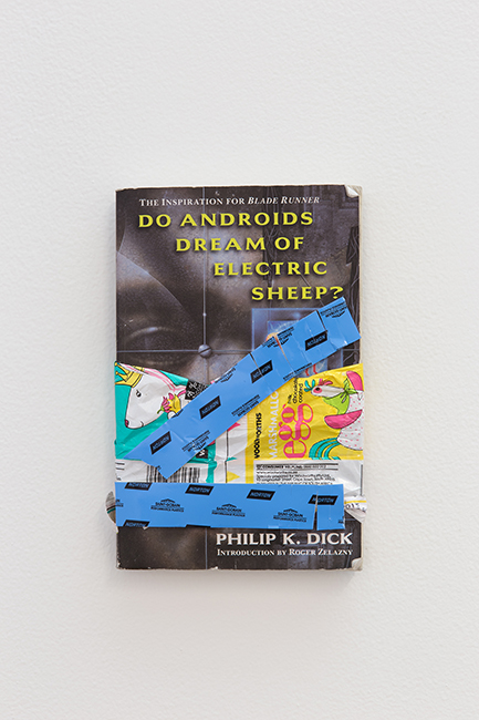 Marvin Luvualu Antonio, But do they dream of electric chocolate, 2015. Book, plastic and adhesive, 13.5 x 20.5 x 2cm.