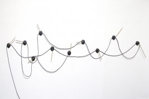 Jared Ginsburg, <i>Science Fiction (Gauges)</i>, 2015. 10 Motors, black cord, tape and bamboo; Dimensions variable