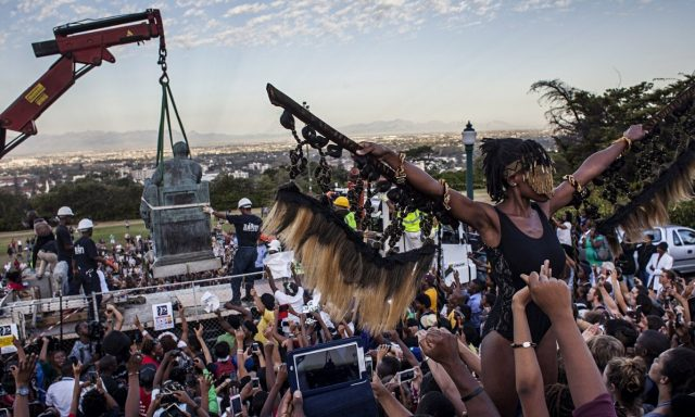 Sethembile Msezane performing in front of the Rhodes statue. Photograph: Charlie Shoemaker/Getty Images Europe