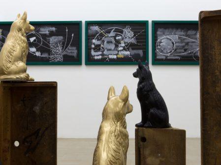 Kemang Wa Lehulere, Cosmic Interluded Orbit (detail), 2016. Salvaged school desks, ceramic dogs, chalk and paint on wall-mounted blackboards