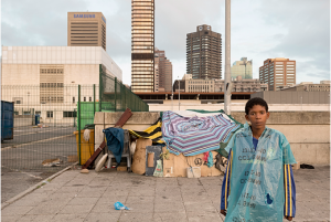 David Lurie Young boy and his 'home', station precinct, Cape Town city centre, 2013. Digital print on fibre-based archival paper, 65 x 97 cm