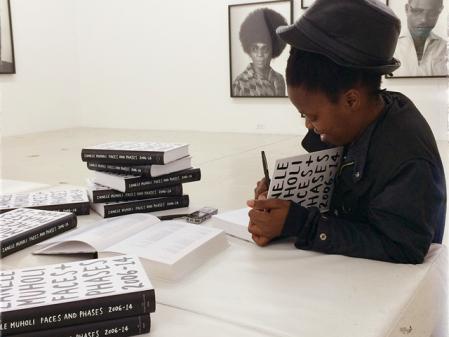 Zanele Muholi Muholi autographing Faces and Phases