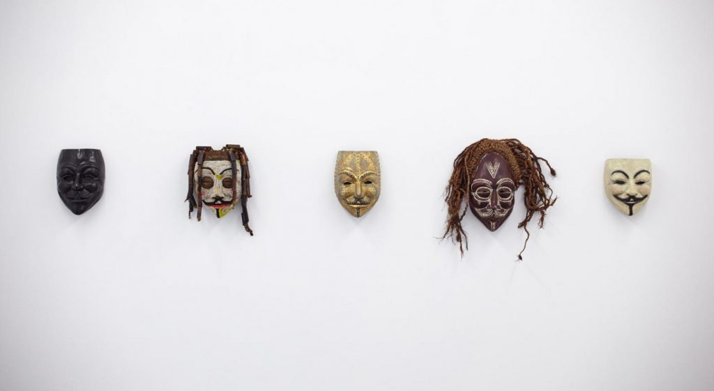 Dan Halter, V for Vendetta, 2015. African masks, dimensions variable