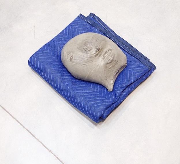 Jean-Luc Moulene, <i>Tronche / Moon Face (Paris, May 2014)</i>, 2014. Polished concrete, blue blanket, 26 × 18 × 22 cm.