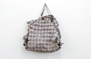 Dan Halter, <i>Kure Ndokusina Kwachiri Unofa Wasvika</i> (loosely translated from Shona: Where There's A Will, There's A Way), 2014. Found plastic weave bag with custom woven tartan, fabric 69 x 105 cm