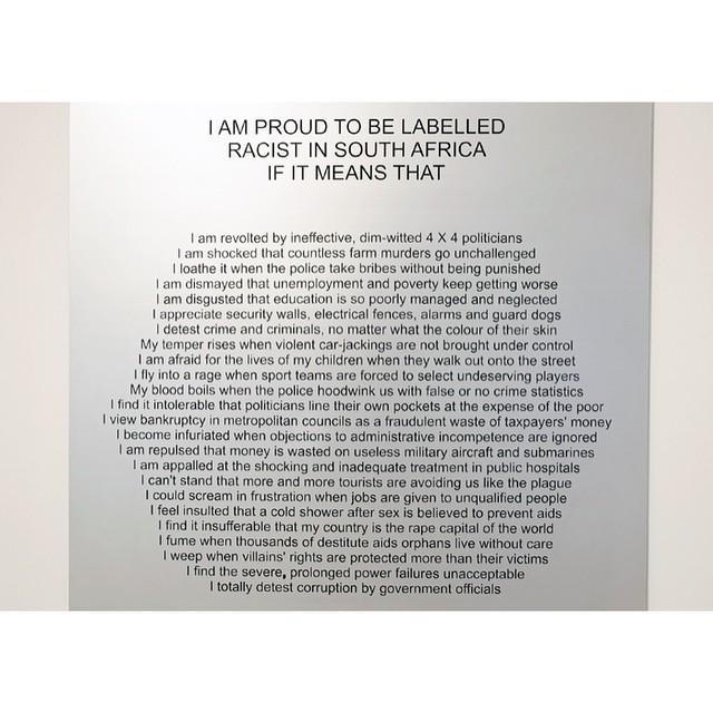 Willem Boshoff, Racist in South Africa, 2011. Anodised aluminium panel. 120 x 120 x 0.3 cm