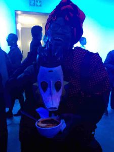Bongi Dhlomo feeds her mask some soup