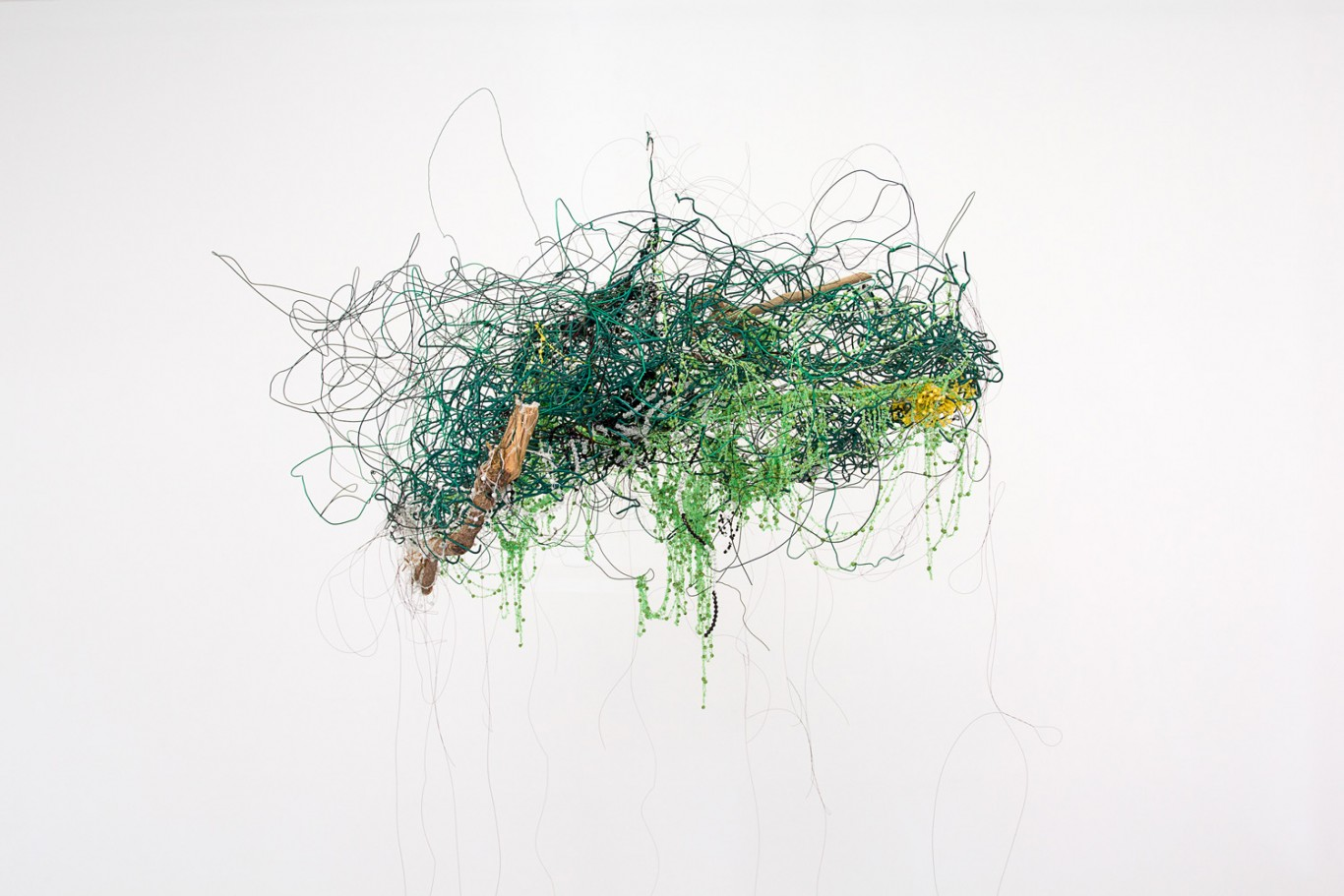 Igshaan Adams, Ontgroei, 2016. Found wire fence, wood, string-beaded necklaces and wire; approx. 110 x 90 x 43 cm