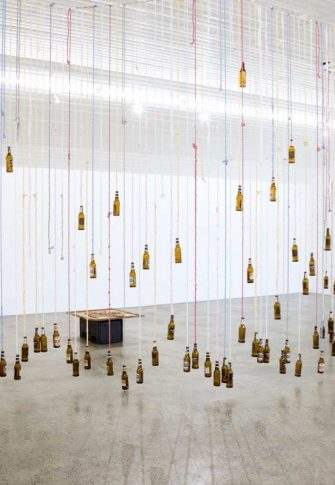 Lungiswa Gqunta, Divider, 2016. Mixed media installation (knotted fabric, and beer bottles), approx. 210 x 700 x 340cm
