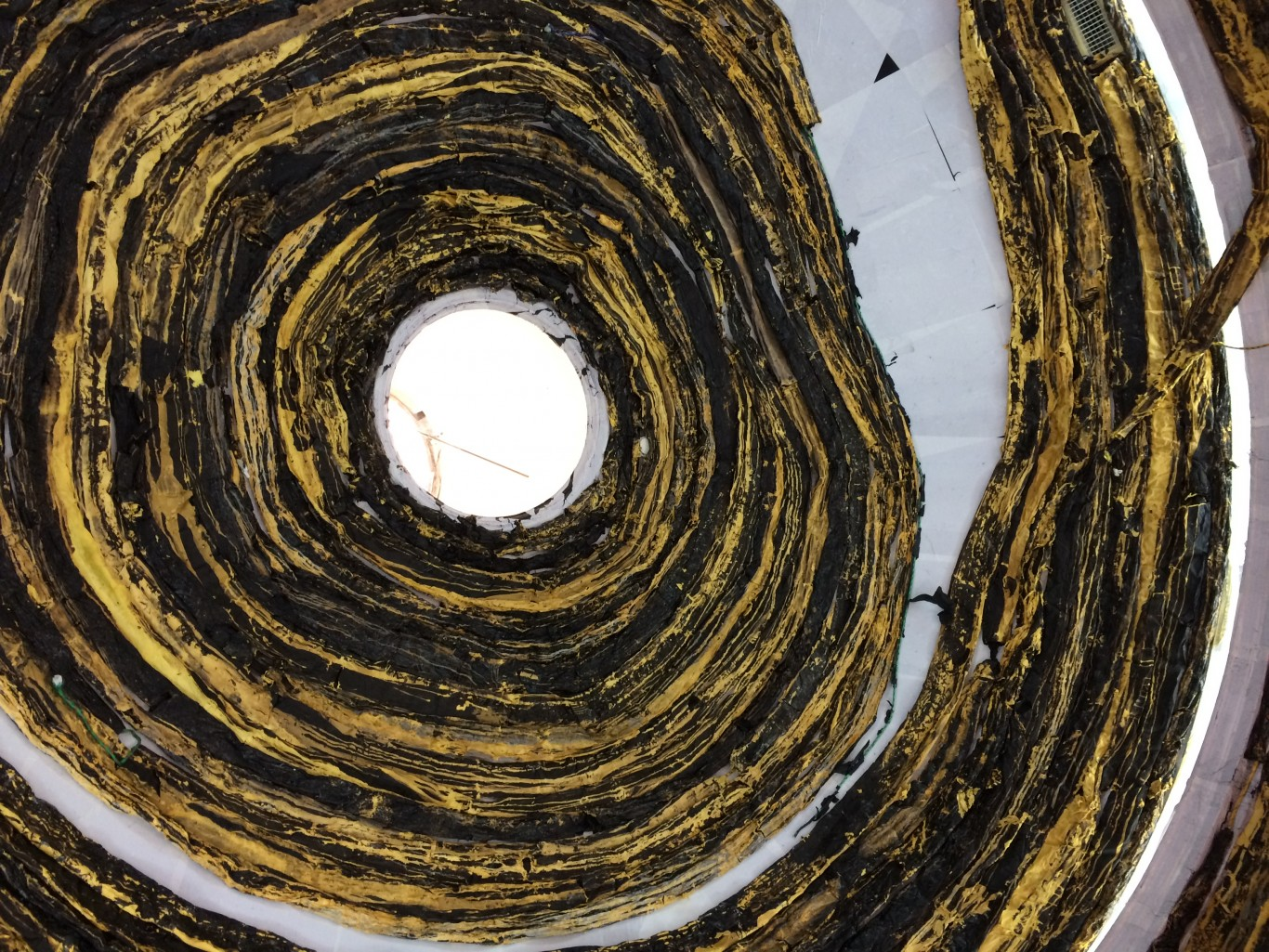 The rotunda, spiralling with painted-and-bleached black-and-gold paper.
