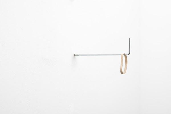 Ruann Coleman, <i>Stretch I</i>, 2017. Carved rubber, wood, steel, 12 x 3 x 26 cm