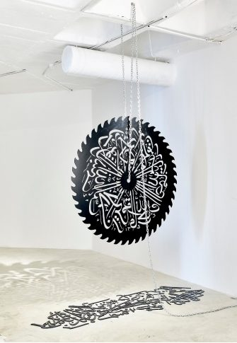 Mounir Fatmi, Mother Language, 2017. Steel blade and cut outs 150 cm diameter