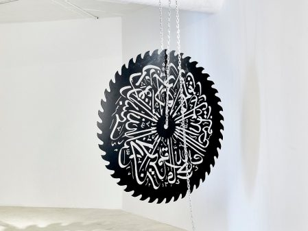 Mounir Fatmi Mother Language, 2017. Steel blade and cut outs 150 cm diameter