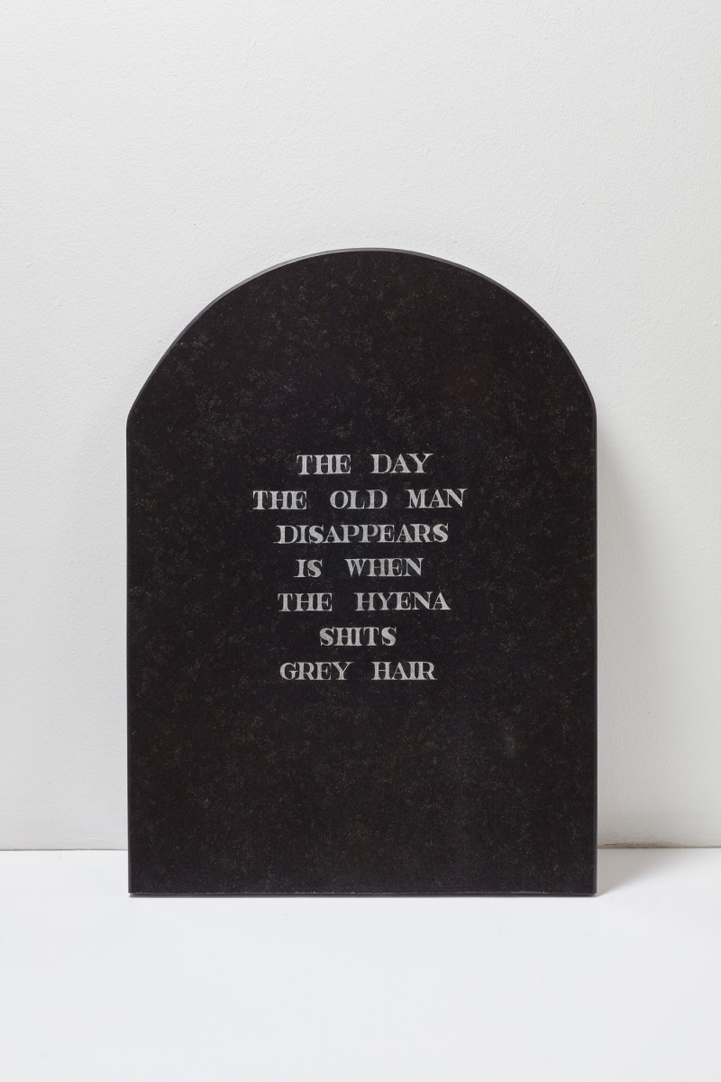 Dan Halter, <i>The Clothes of The Dead White Man / obroni wawu</i>, 2017. Engraved headstone, 75 x 54.5 x 4 cm